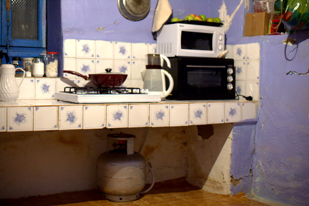 The original kitchen with some improvised cooking arrangements, Notice how low the bench is.