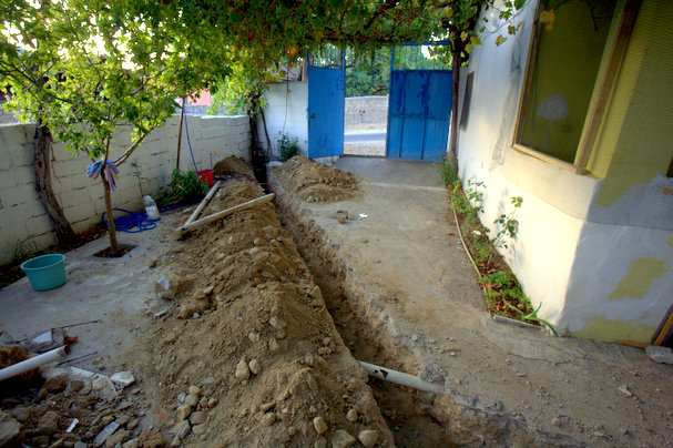 New trench dug under the concrete to lay water and sewer pipes for the new bathroom