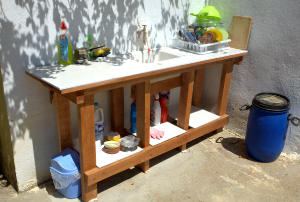 The outdoor kitchen: tiled and stained and seeing lots of use.