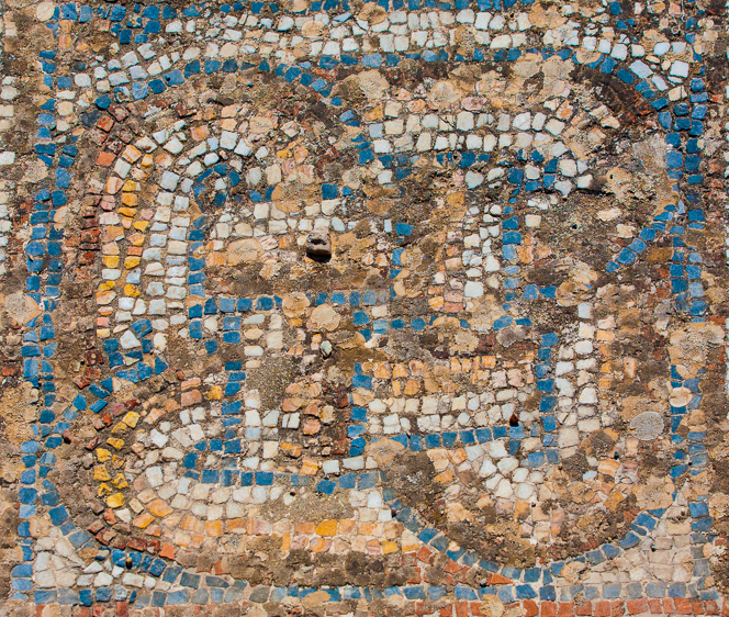 Mosaic tiles. I don't know for sure, but I think this might have been the porch of someone's house.