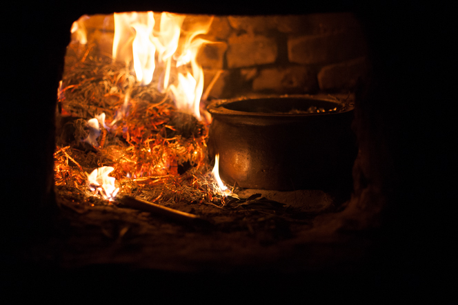 Christmas dinner cooking in a clay oven.