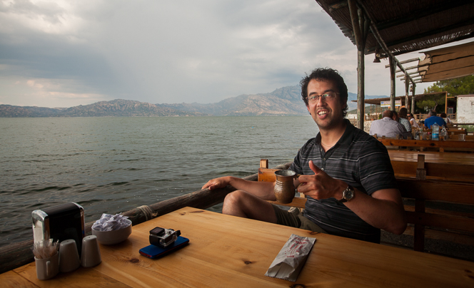 Joe enjoys a mug of ayran by Lake Bafa.