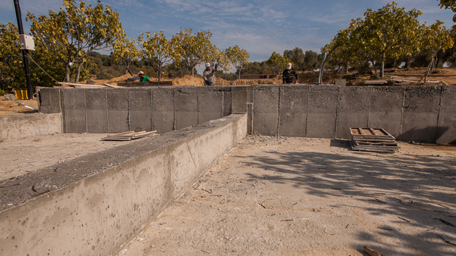 Solid reinforced concrete beams that will support the restaurant.  The step up in the slab is so that rooms one and two will sit a little higher and not cut too deeply into the hillside.