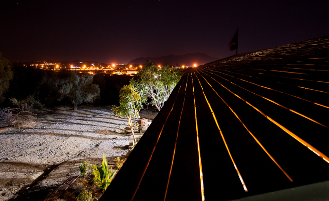 The roof at night; lights of Germencik in the background.